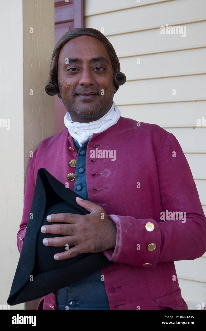 USA Virginia VA Colonial Williamsburg an African American interpreter docent in period costume on Duke of Gloucester - Stock Image