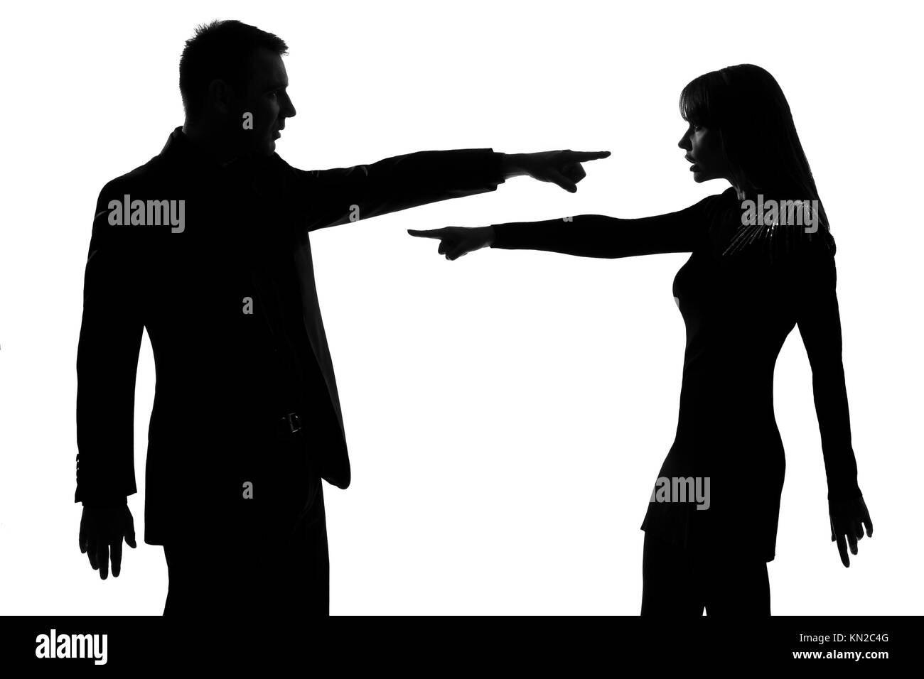 one caucasian couple man and woman pointing at each other expressing accusation in studio silhouette isolated on - Stock Image