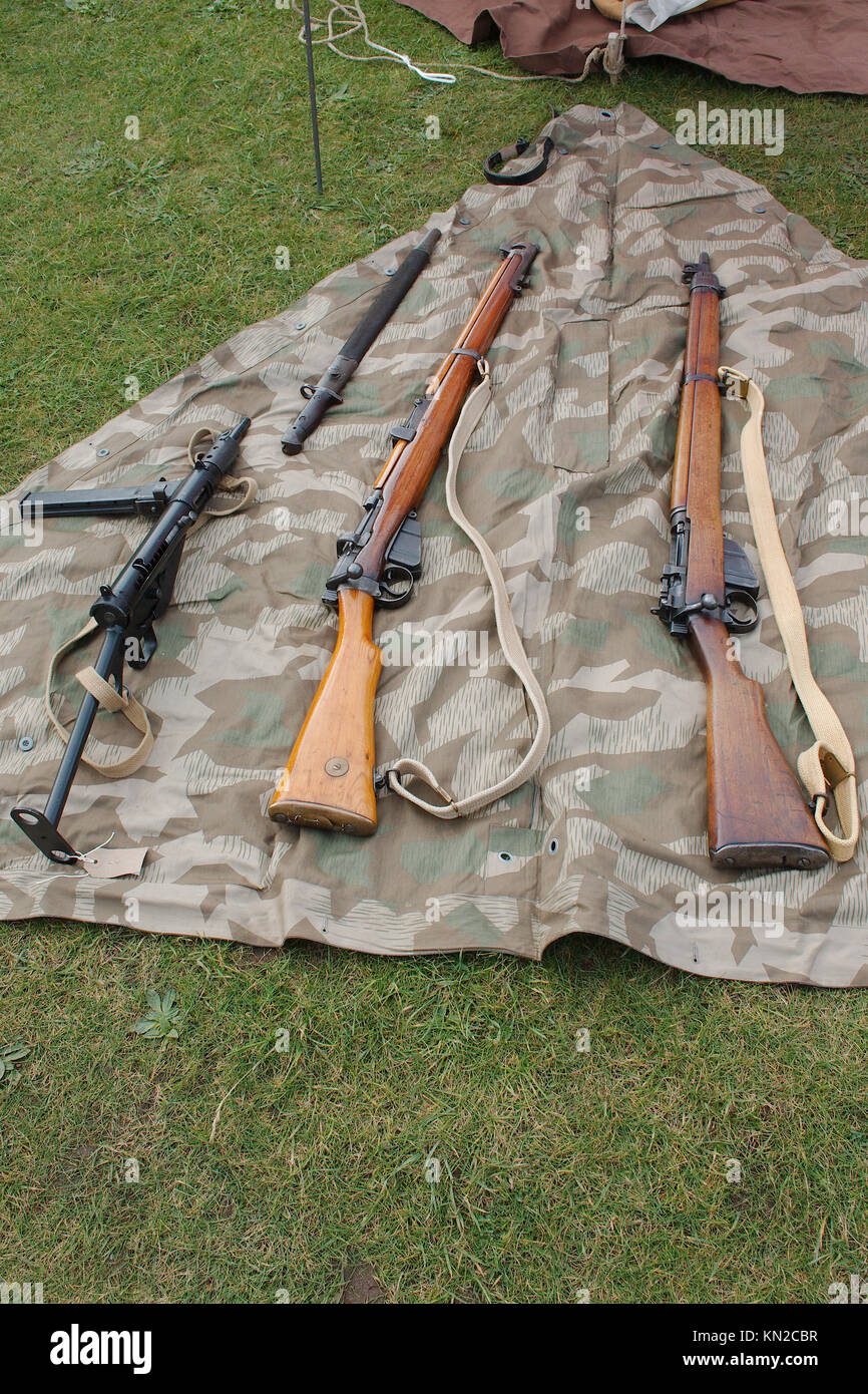 World war 2 era historical British army  small arms; Lee Enfield rifles and Sten sub-machine gun. - Stock Image