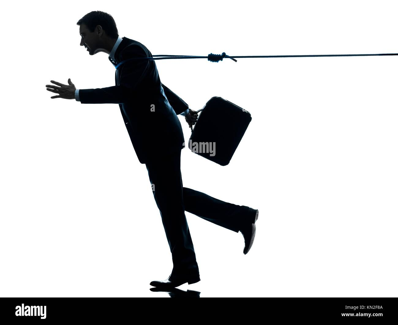 one caucasian business man catched by lasso rope in silhouette studio isolated on white background - Stock Image