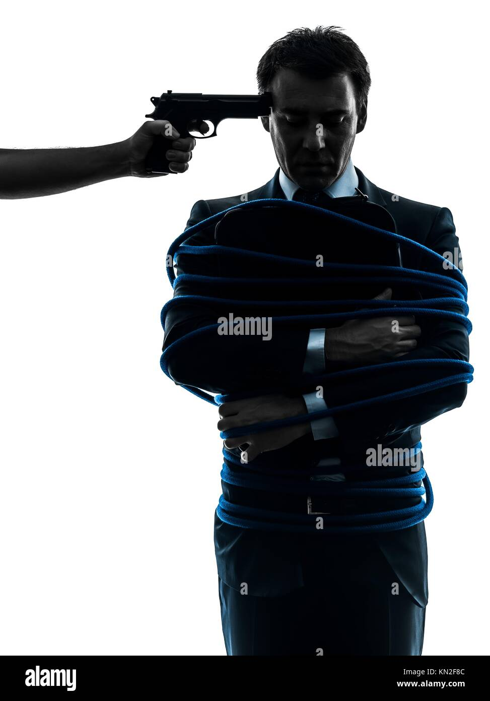 captive hostage business man in silhouette studio isolated on white background - Stock Image