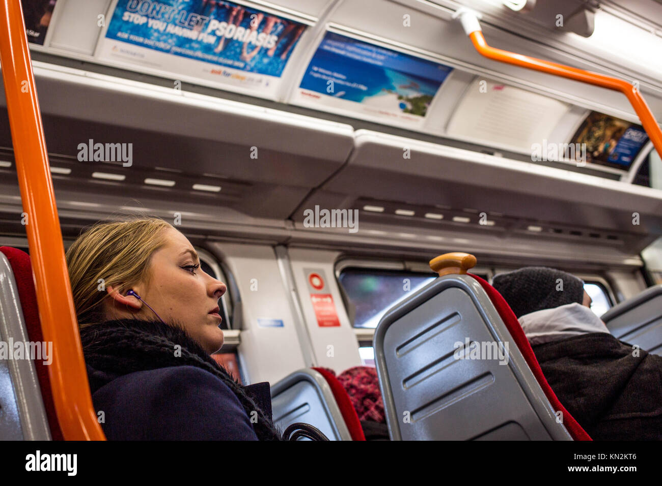 Candid Portrait of A Commuter Traveling on a Train In England - Stock Image