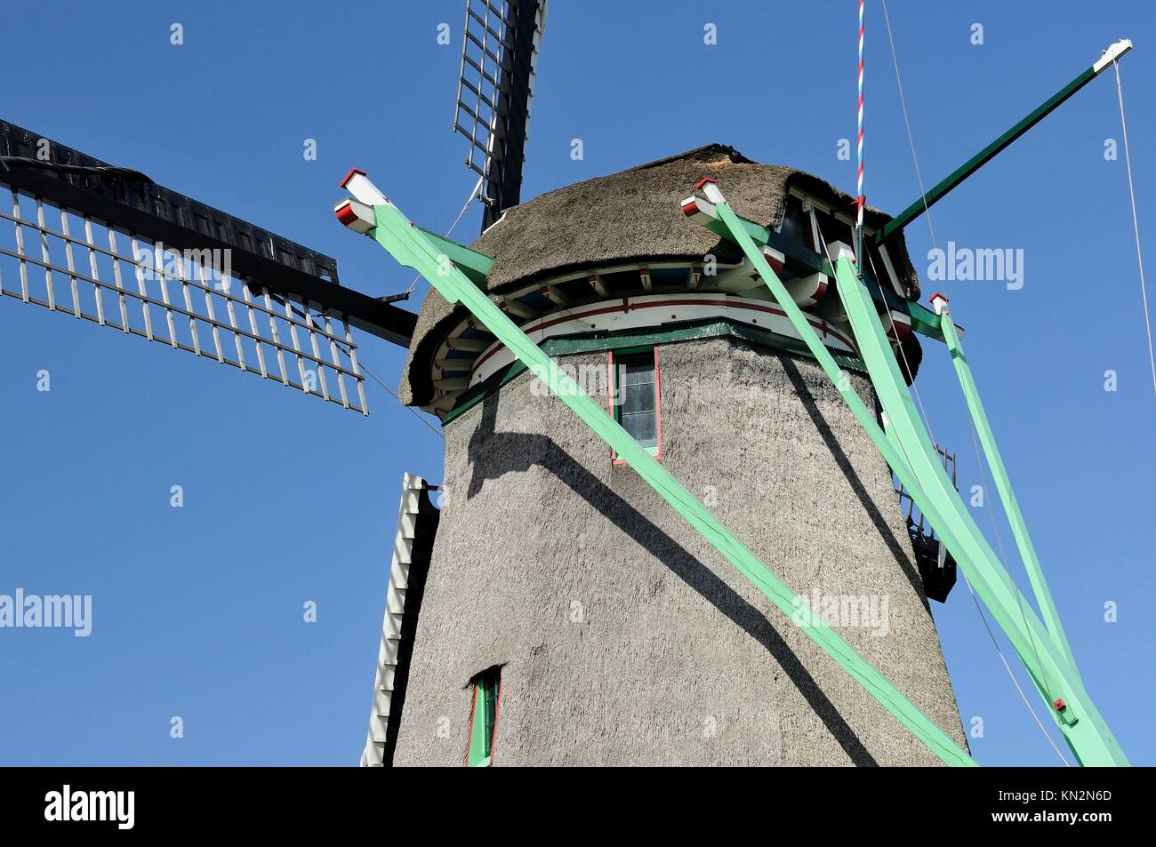 detail of mechanism that moves the vanes of traditional windmill at touristic location, shot in bright spring light - Stock Image