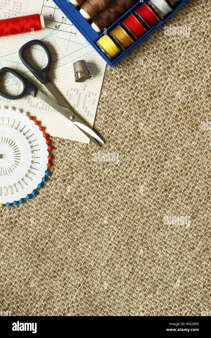 Fabrik, scisors ans sewing items with copy space. - Stock Image