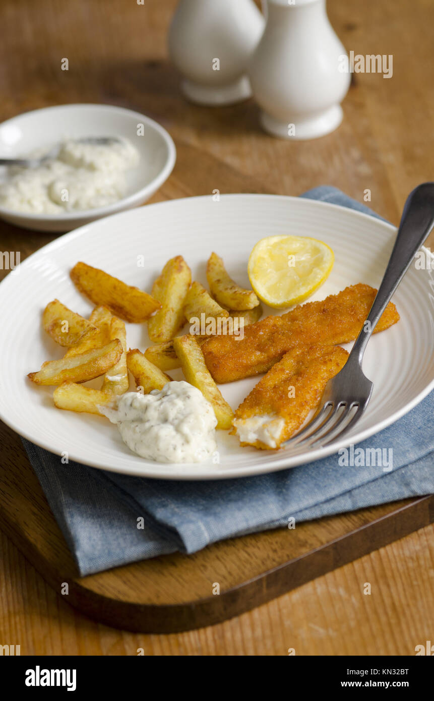 Fish fingers with french fries and tartar sauce. - Stock Image