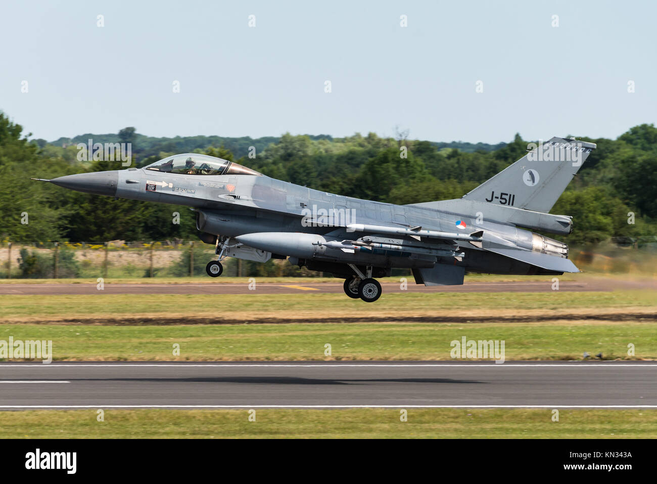 A F-16 fighter jet of the Royal Netherlands Air Face taking off at the RAF Fairford airbase. - Stock Image