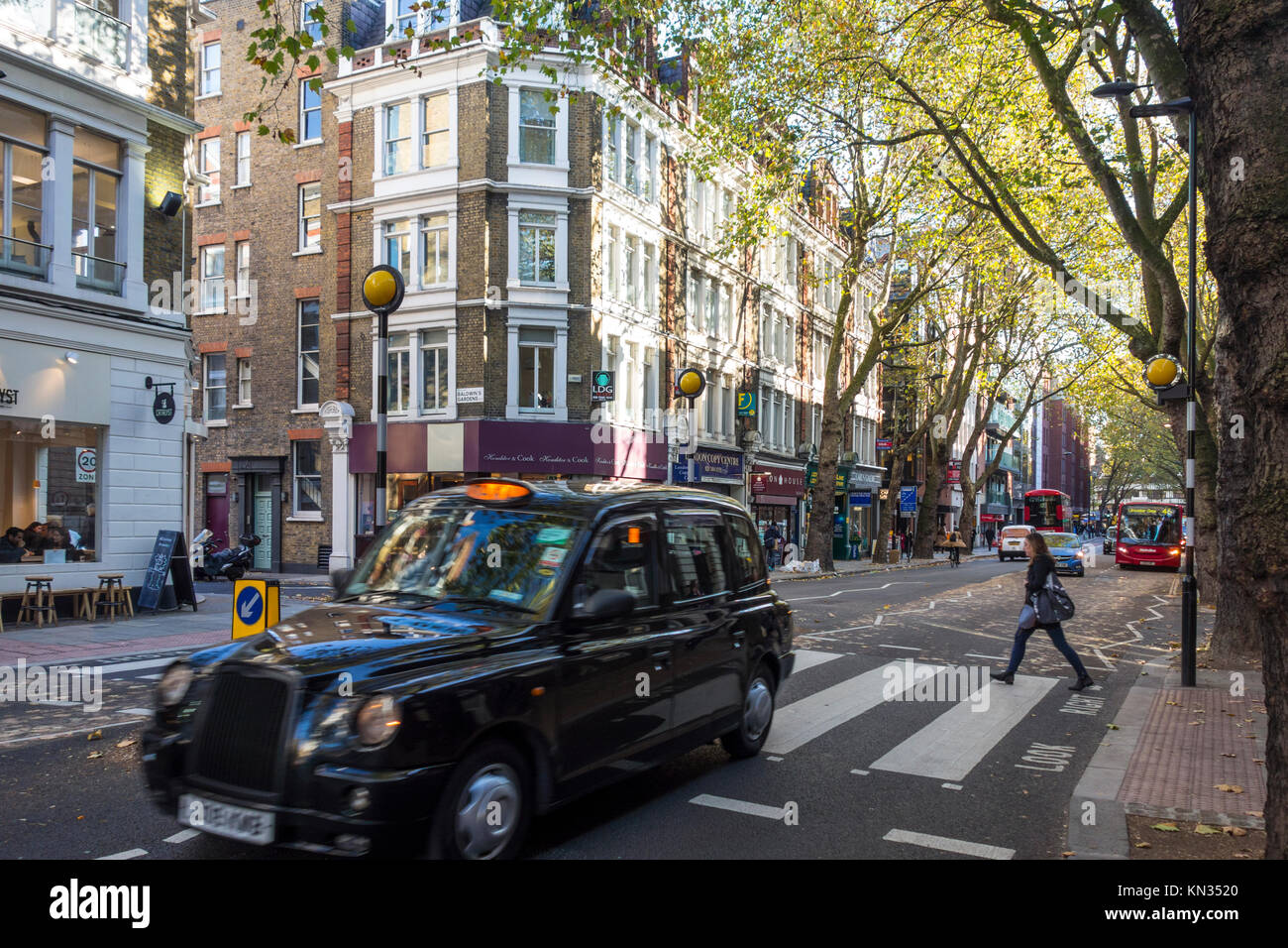 London black cab taxi at a pedestrian crossing on Grey's Inn Road, Holborn, London - Stock Image