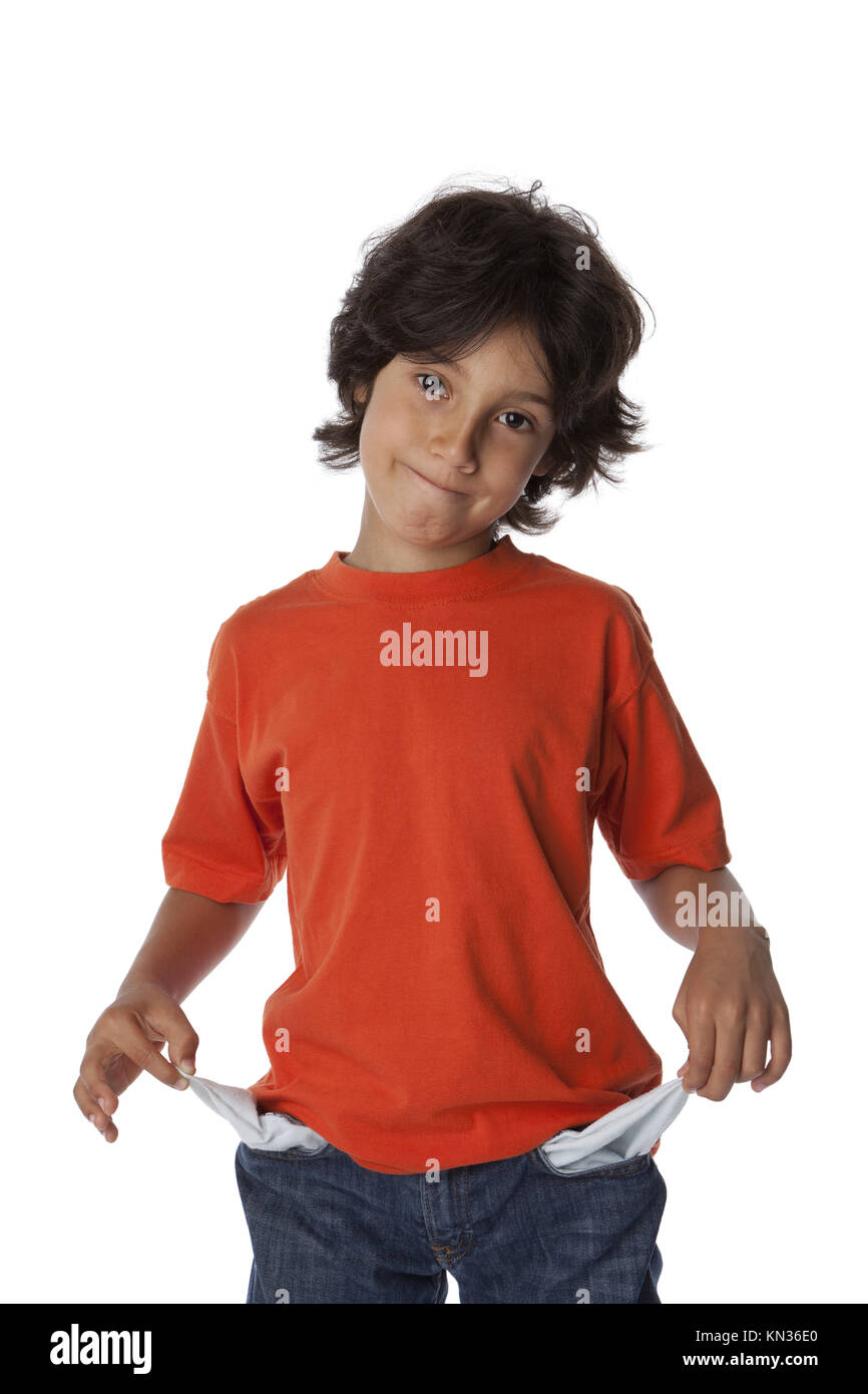 Broke little boy with empty pockets on white background. - Stock Image