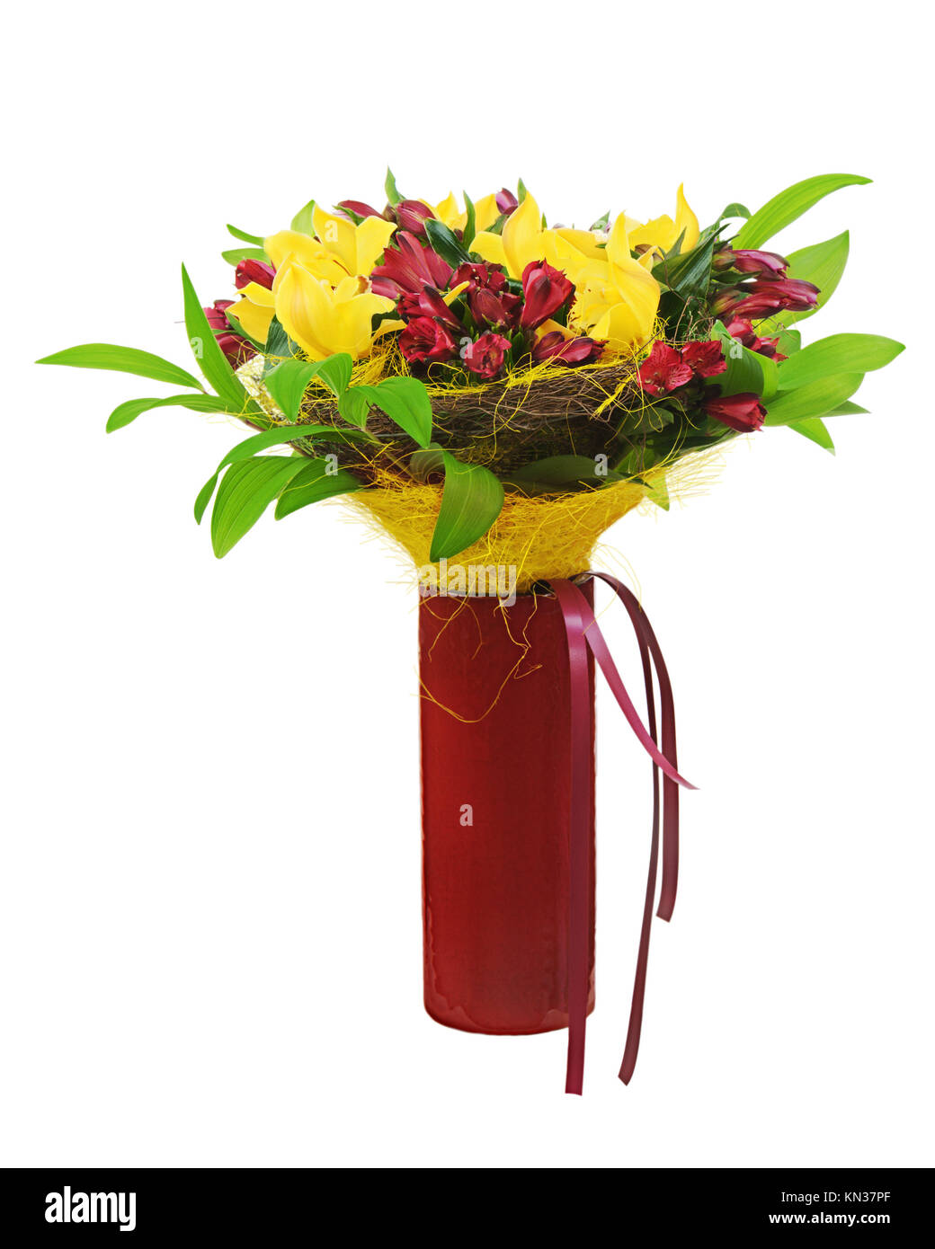 Colorful flower bouquet arrangement centerpiece in red vase isolated ...