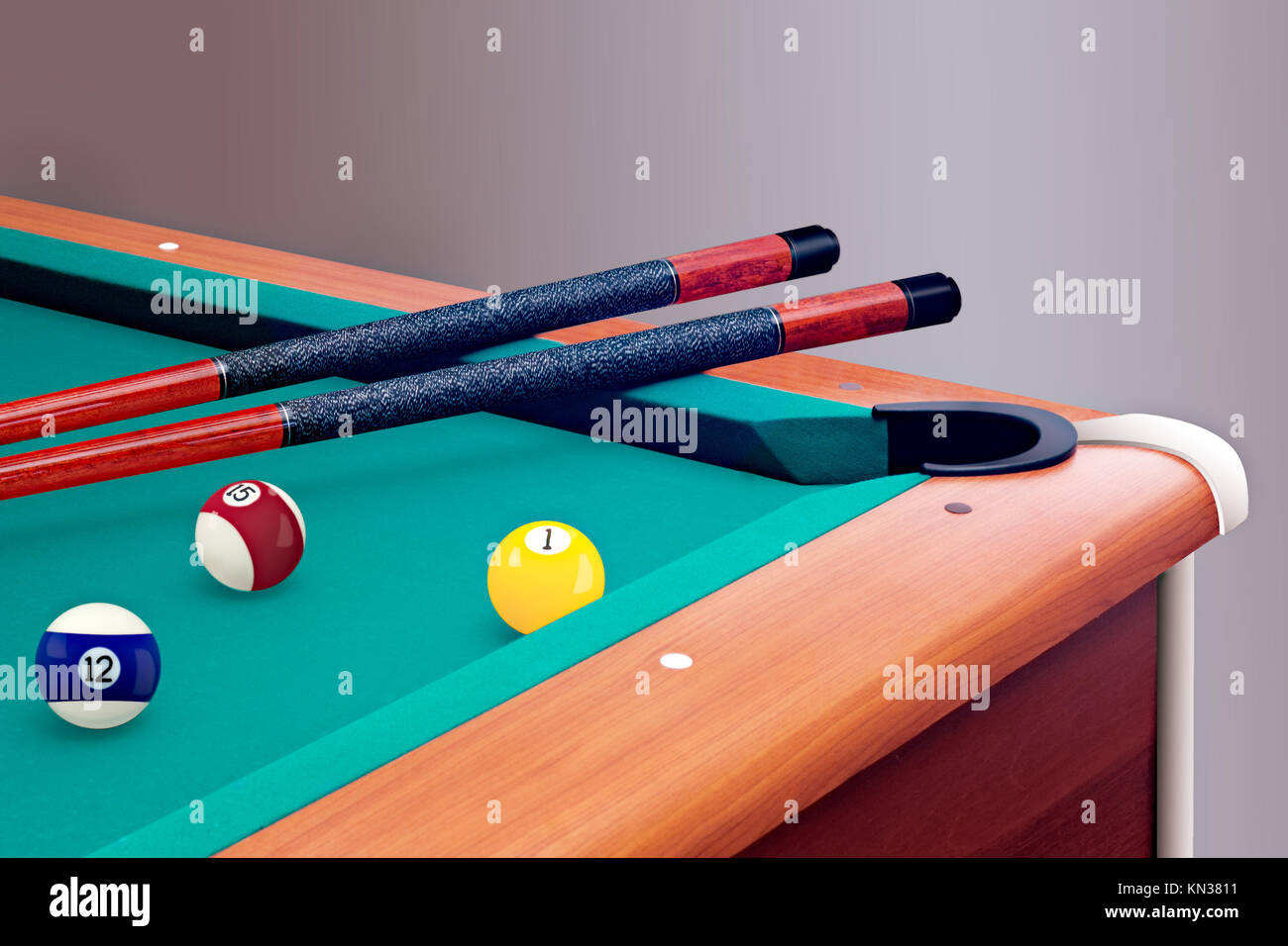 Green billiard table with balls and cues. - Stock Image