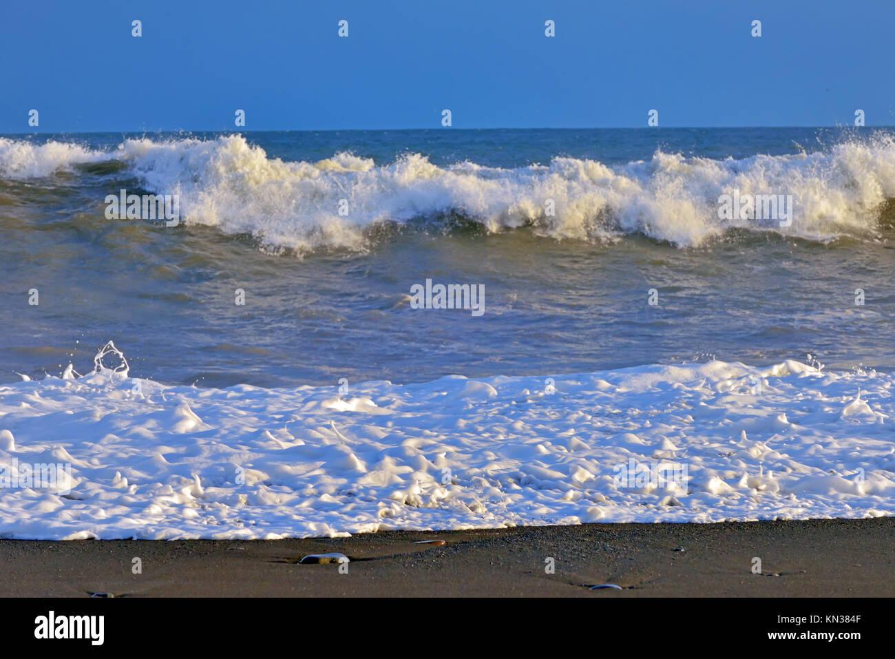 waves on atlantic ocean coast in iceland. - Stock Image
