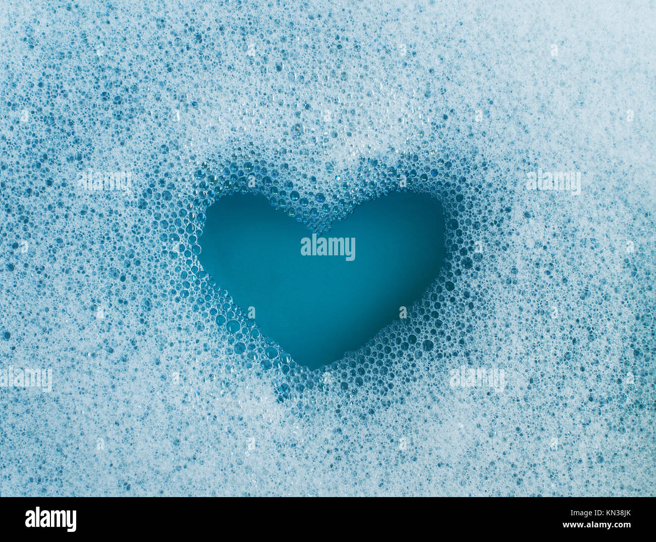 Heart shape created out of soap suds. Stock Photo