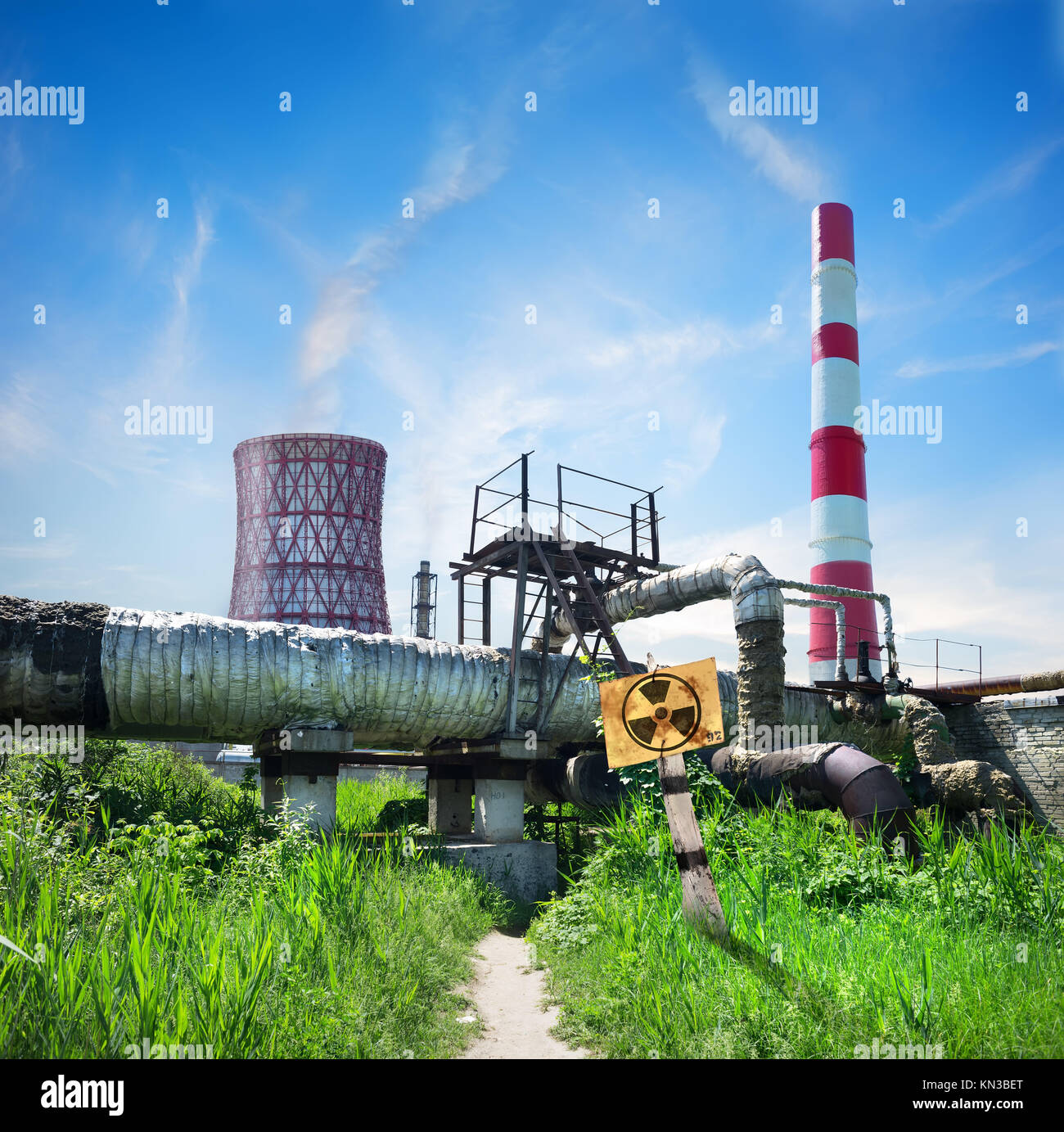 Nuclear reactor and smoke stack in afternoon. - Stock Image