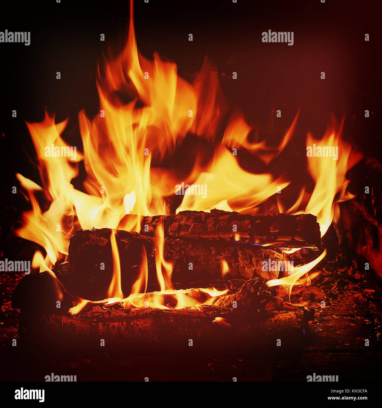 Fireplace with birch firewood and flame with retro filter effect. - Stock Image
