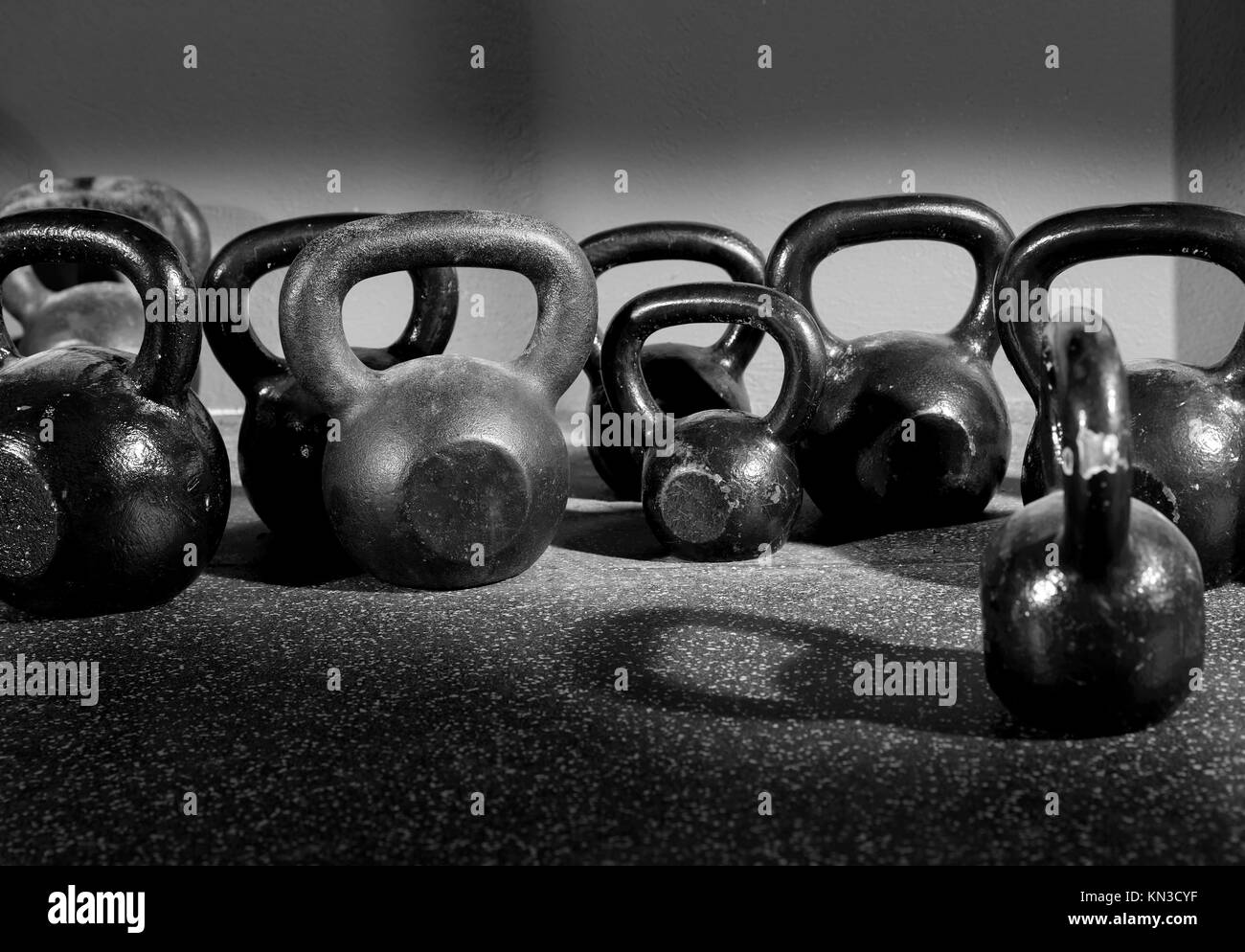 Kettlebells weights in a workout gym in black and white. - Stock Image