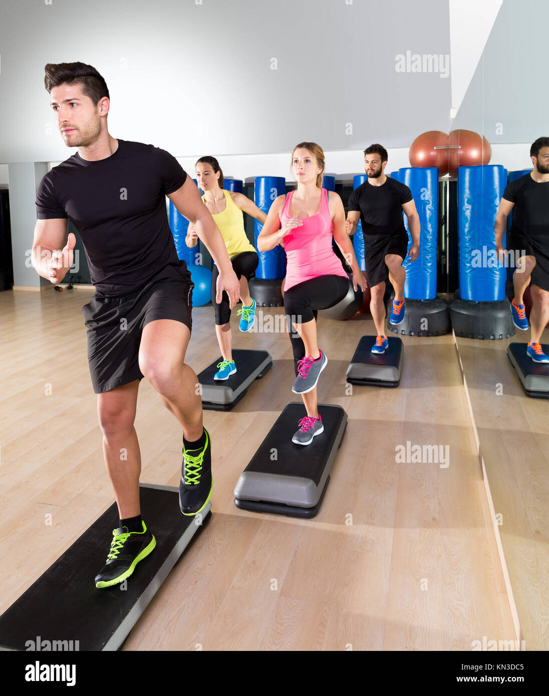 Cardio step dance people group at fitness gym training workout. - Stock Image