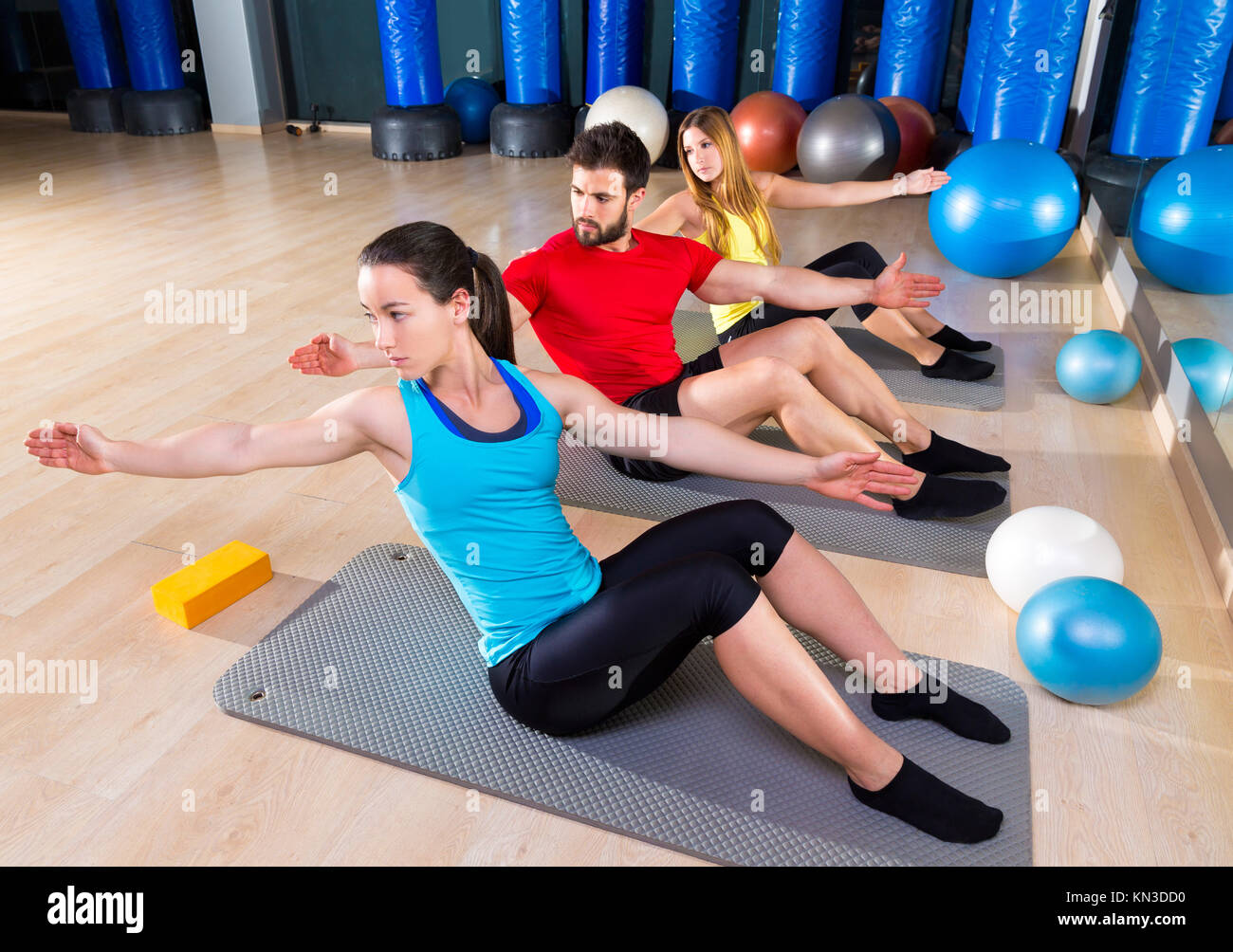 Pilates people group exercise man and women at fitness gym. - Stock Image