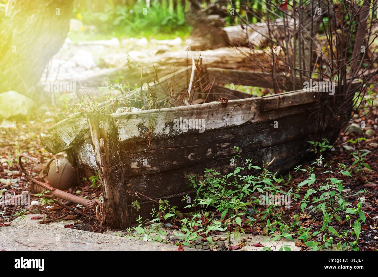 Last place of old broken boat in autumn garden. Vladivostok, Russia. - Stock Image