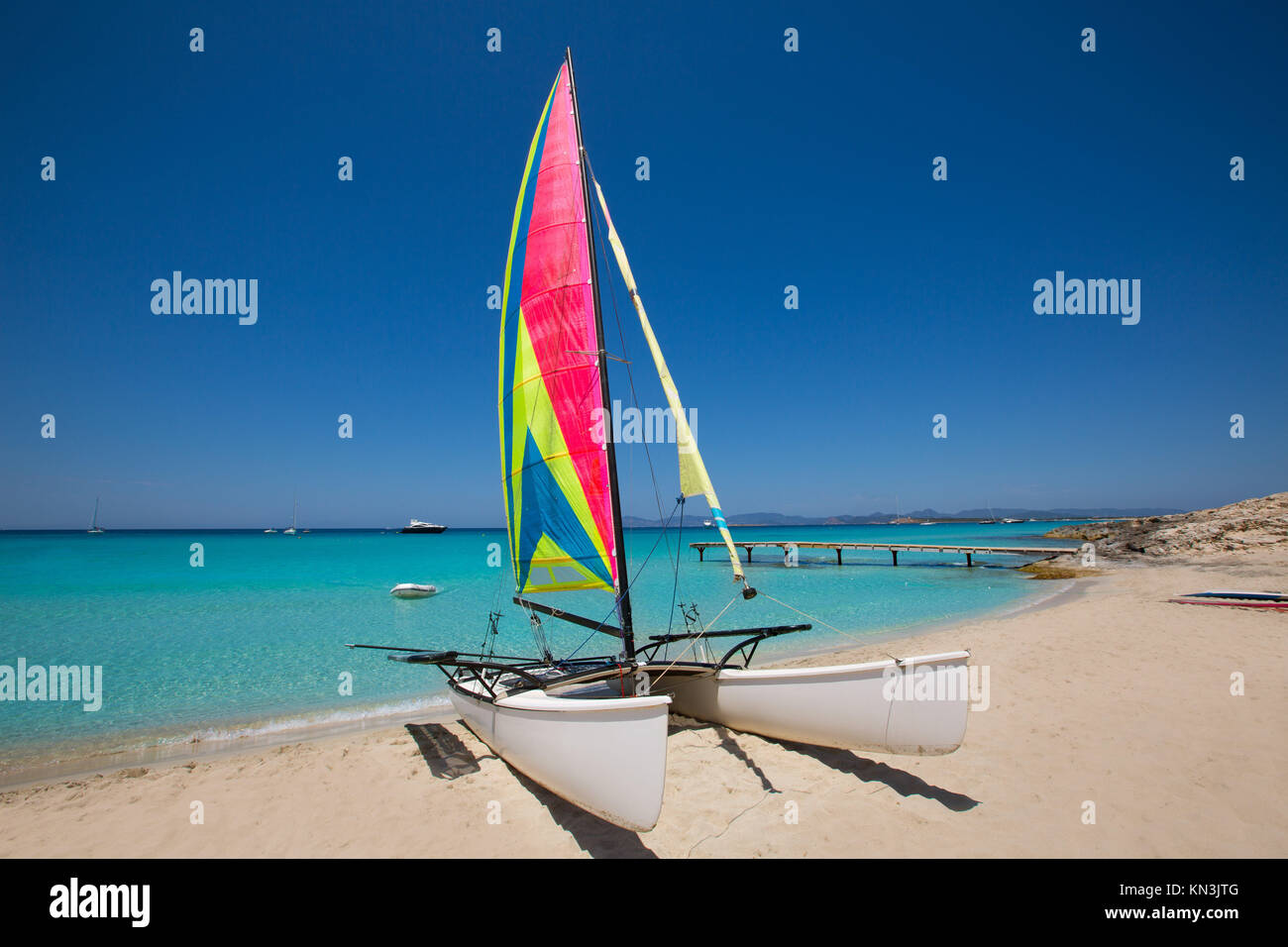 Catamaran sailboat in Illetes beach of Formentera at Balearic Islands. - Stock Image