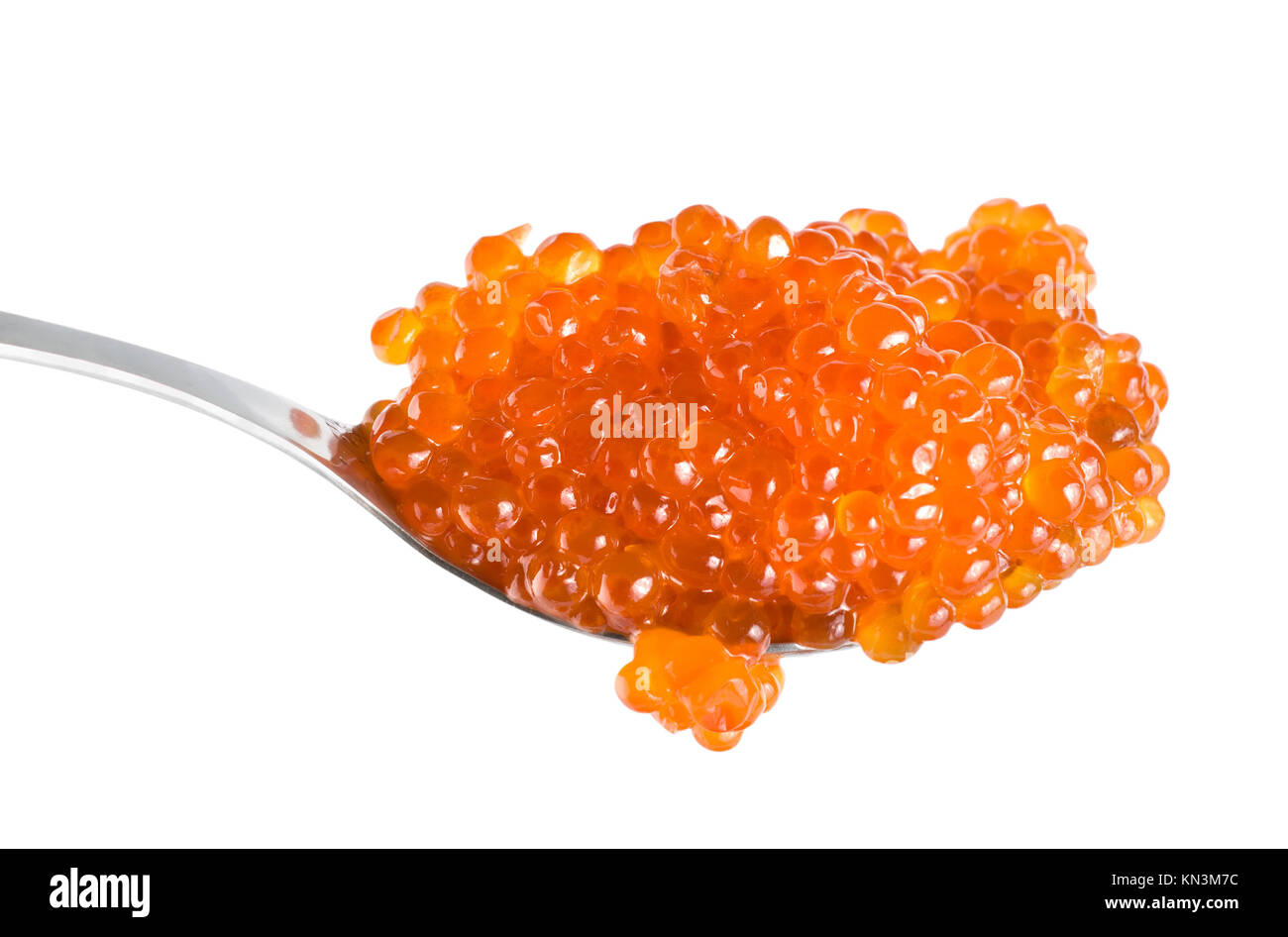 Large red caviar in spoon isolated on white background. - Stock Image