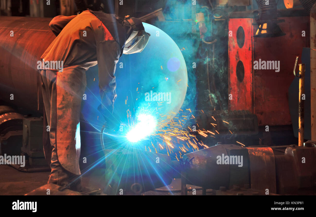 worker with protective mask welding metal. Stock Photo