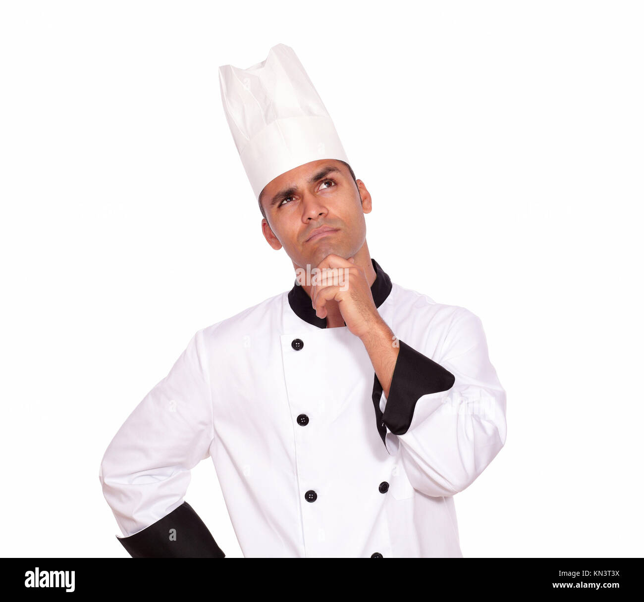 Portrait of a pensive professional chef looking to left up in uniform against white background - copyspace. - Stock Image