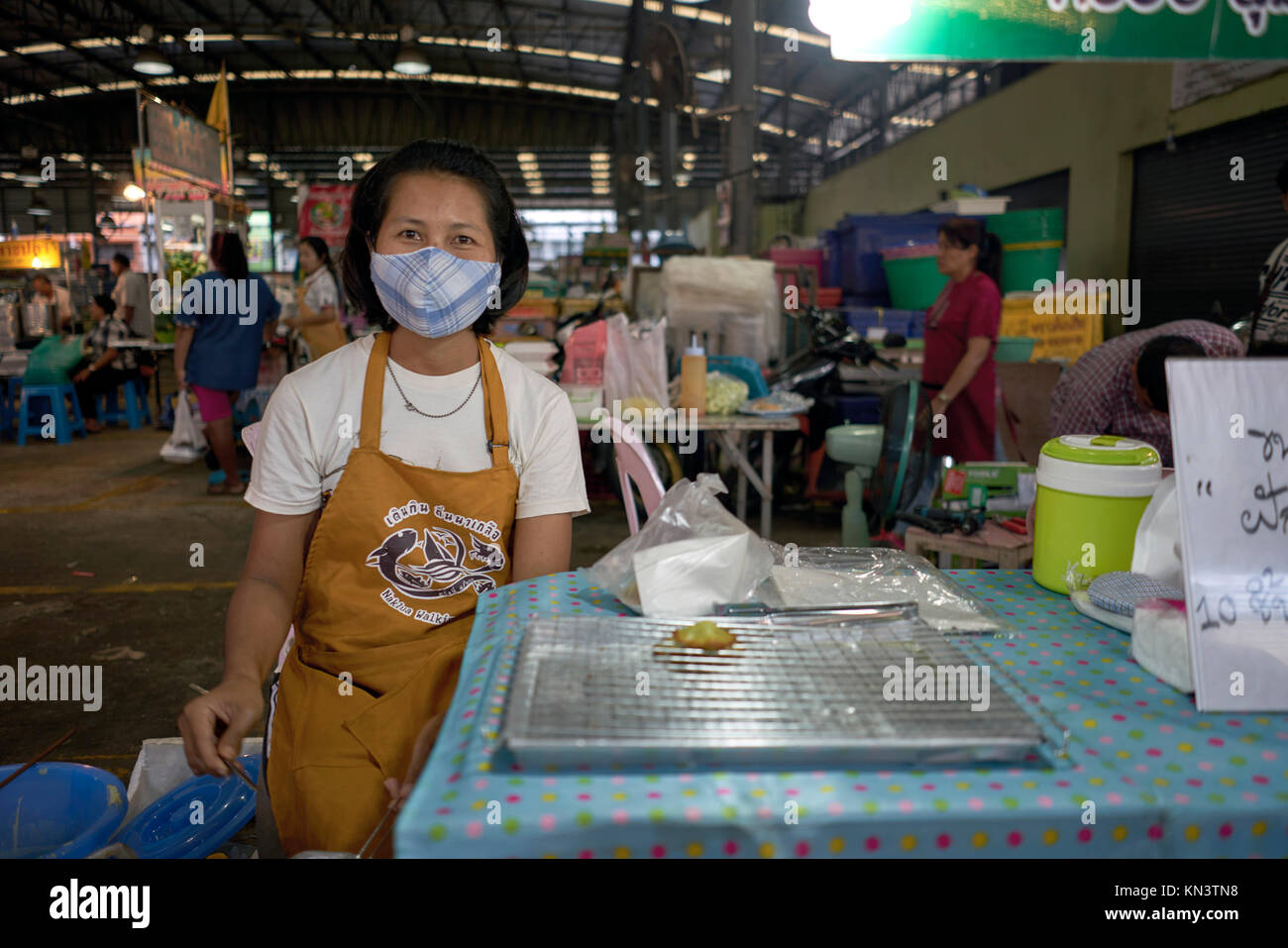 Woman facemask, anti-pollution mask, Thailand street scene - Stock Image