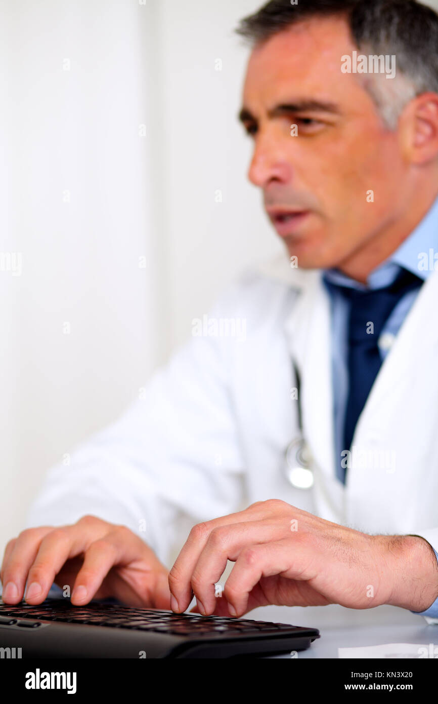 Portrait of a professional medical specialist working at the hospital. - Stock Image