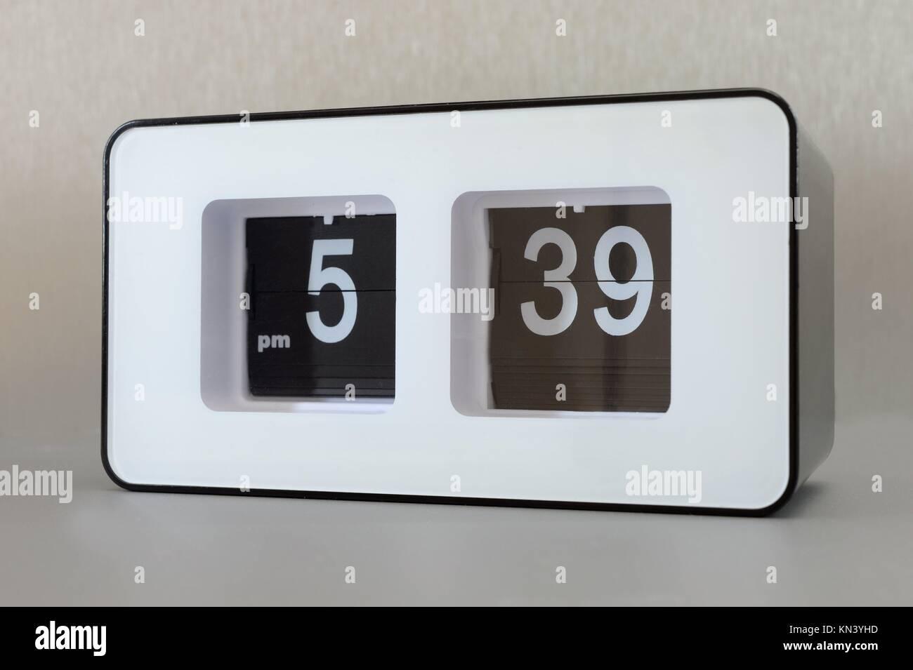 A close up shot of a flip clock. - Stock Image