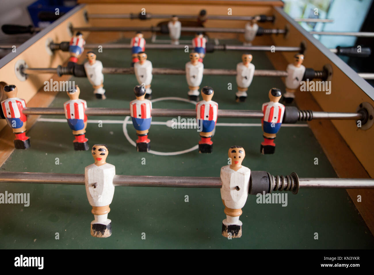 A table for table football in the pub, visible figures of toy mini football players. - Stock Image