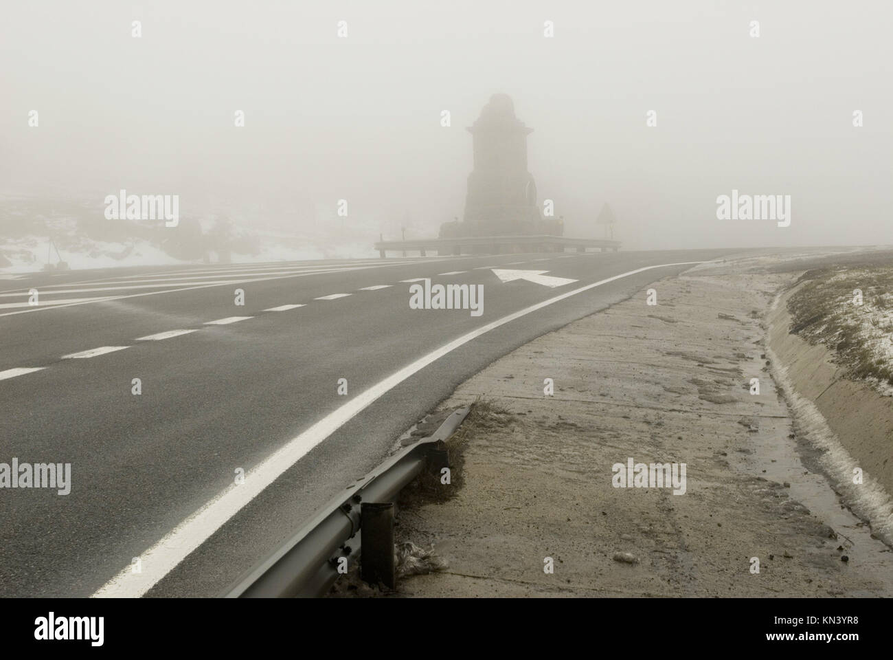 Road and Los Leones Mountain Pass, provinces of Madrid and Segovia, Spain Stock Photo