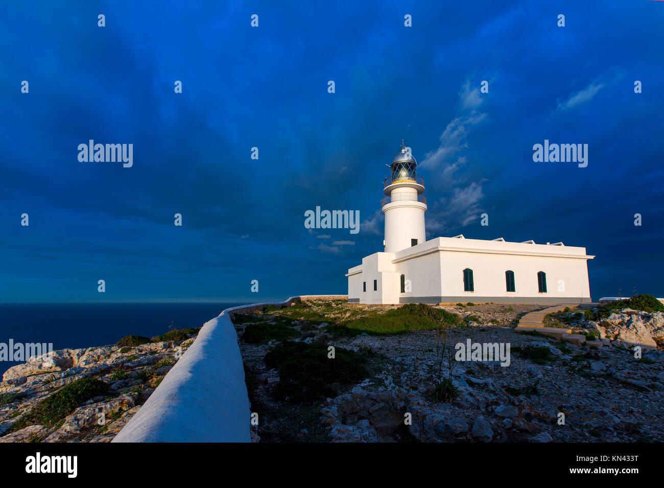 Menorca sunset in Faro Far de Caballeria Lighthouse at Balearic Islands es Mercadal. - Stock Image