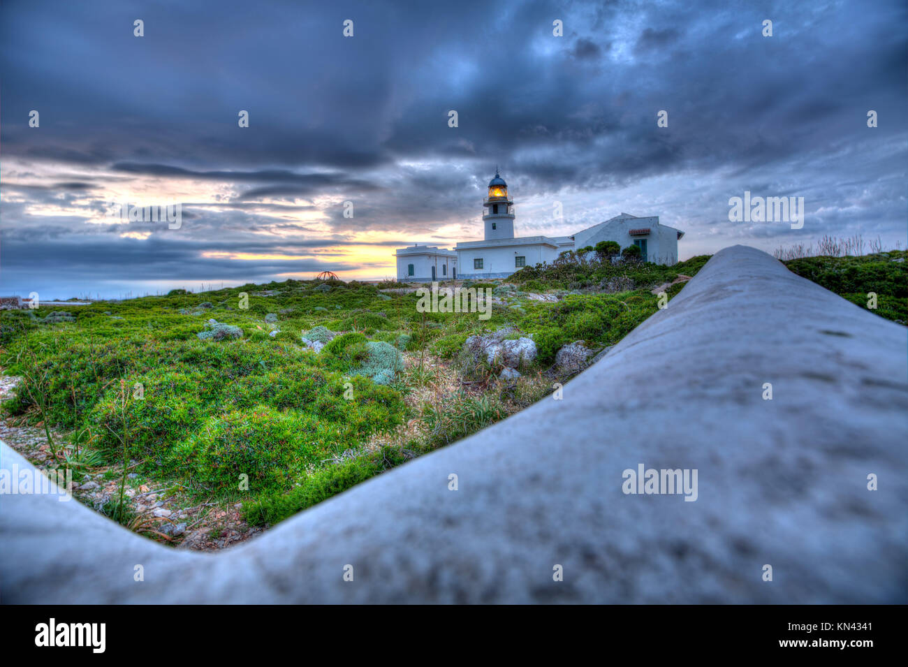 Menorca sunset in Faro Far de Caballeria Lighthouse at Balearic Islands es Mercadal. - Stock Image