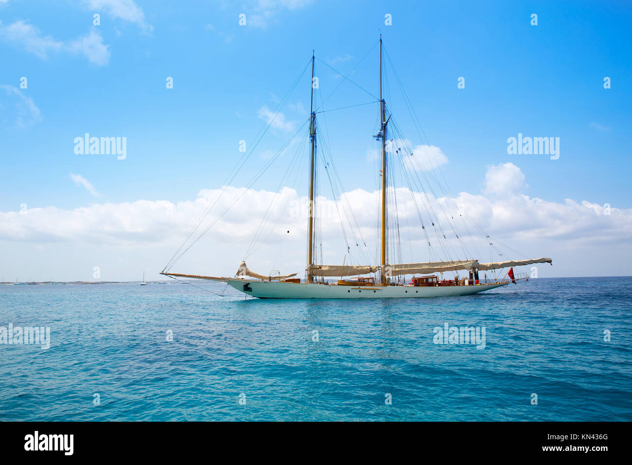 Illetes Illetas Formentera yacht sailboat anchored in turquise Mediterranean. - Stock Image