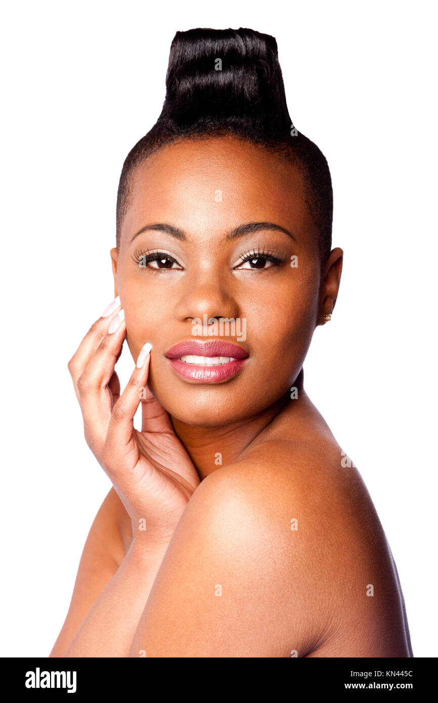 Head of Beautiful young African woman with Mohawk hand on face and bare shoulder, skincare concept, on white. - Stock Image