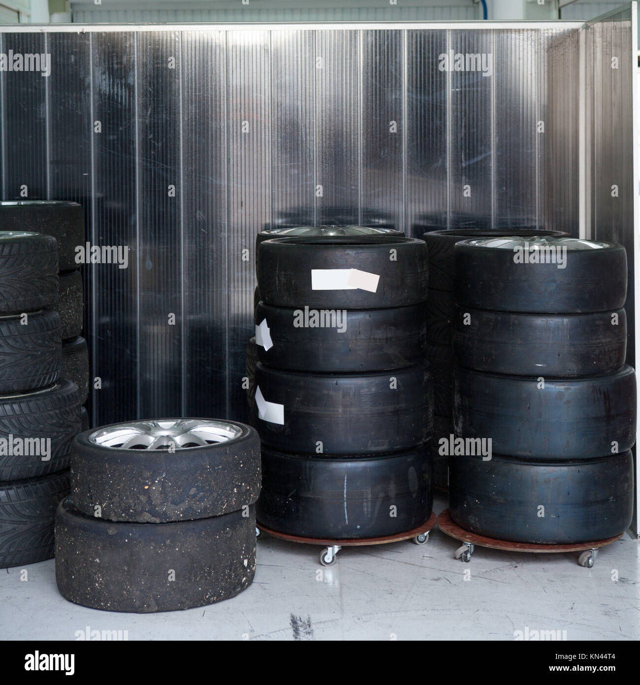 Formula One 1 race tires and wheels in boxes. - Stock Image