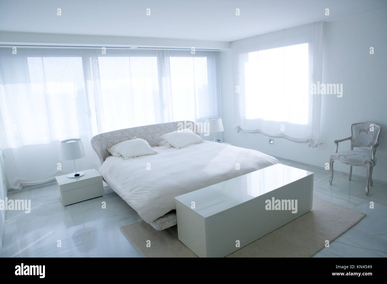 Modern White House Bedroom With Marble Floor And Luminous Windows Stock Photo Alamy
