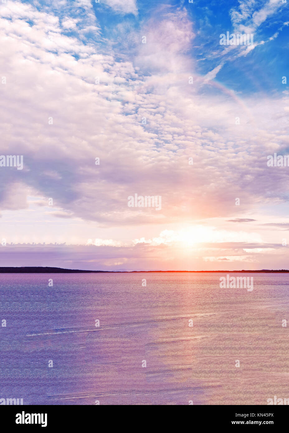 Colorful sunset on the beach. Gulf of Peter the Great. Japanese sea. Vladivostok. Russia. - Stock Image