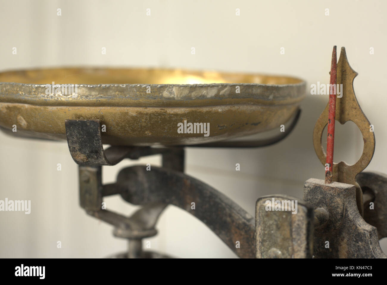Old weighing scale for weighing dough in a bakery. - Stock Image