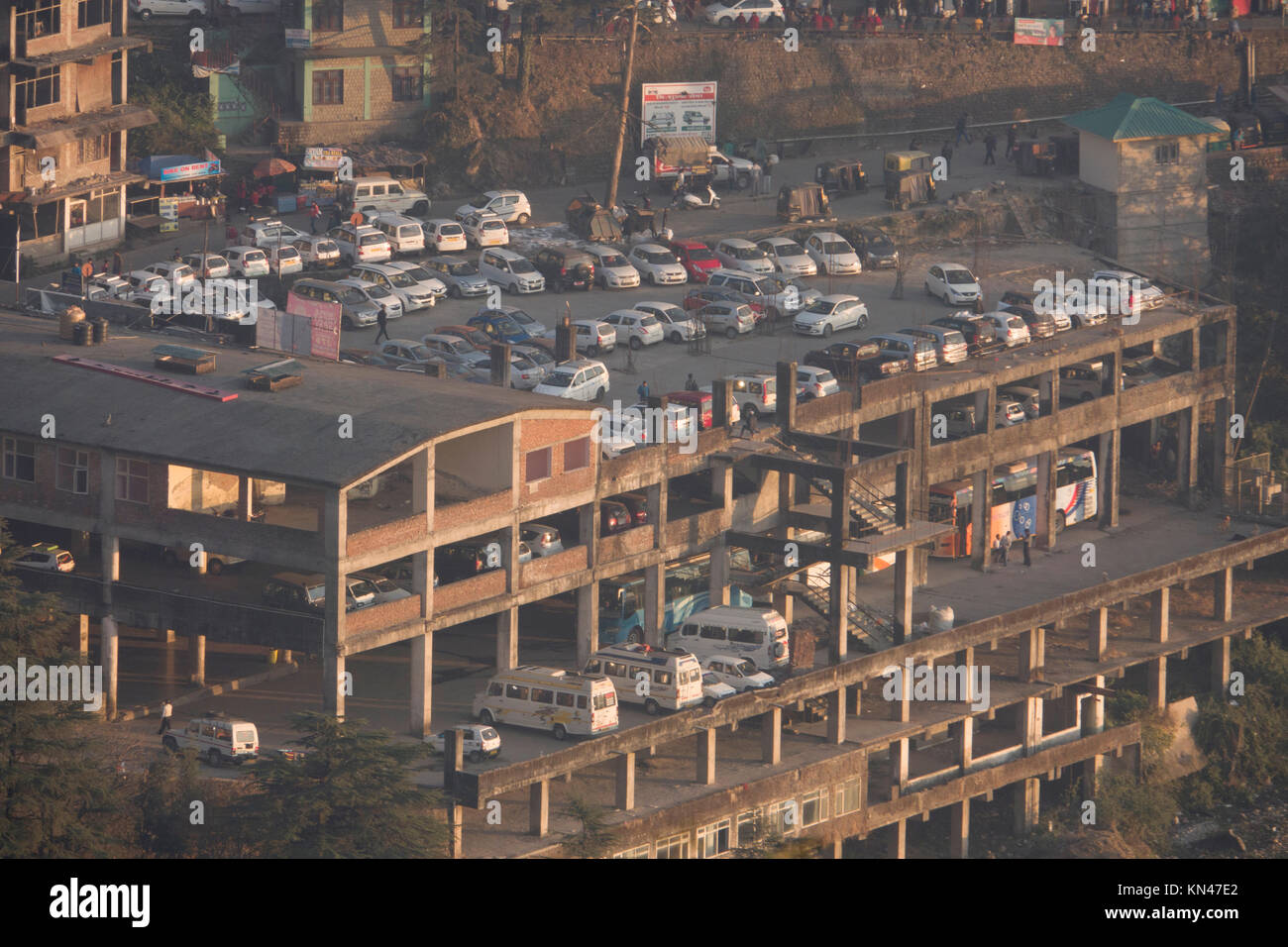 Unfinished multi level building used for vehicle parking in Mcleod Ganj, India - Stock Image