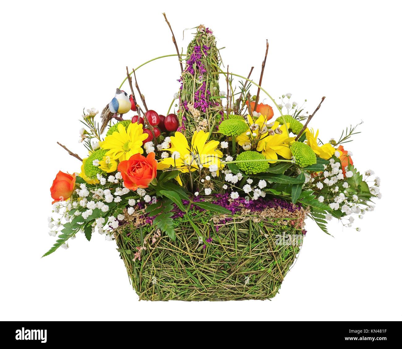 Flowers bouquet arrangement centerpiece in wicker basket isolated on ...