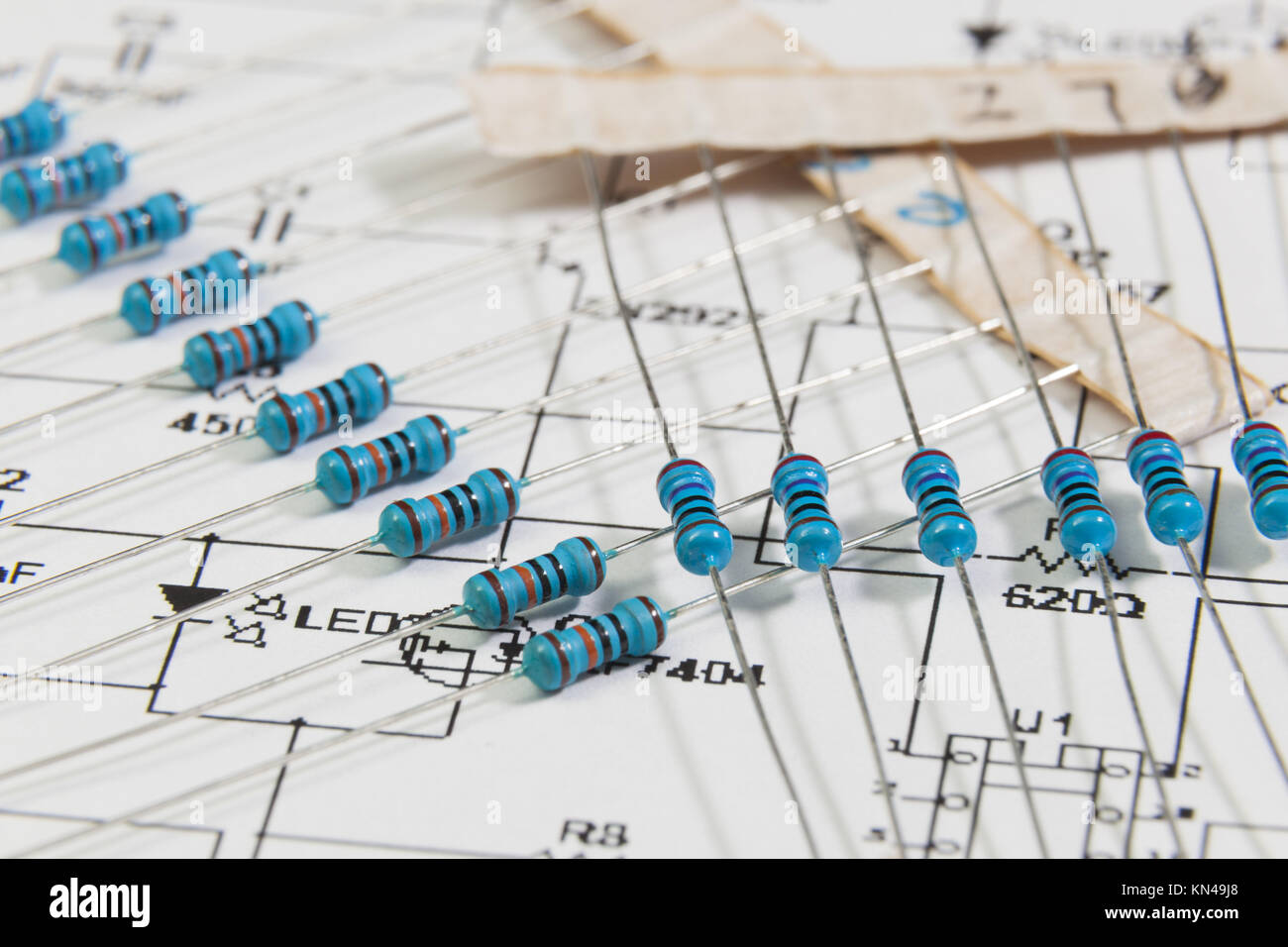 Group of electronic resistors and scheme. - Stock Image
