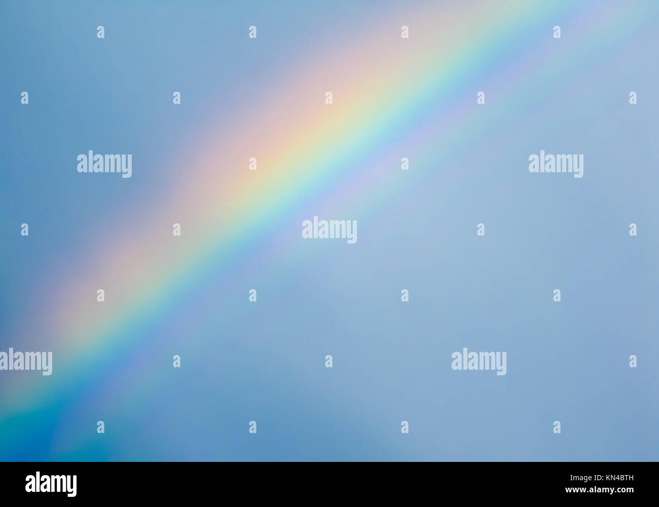 Rainbow on blue sky after rain. Stockholm, Sweden. - Stock Image
