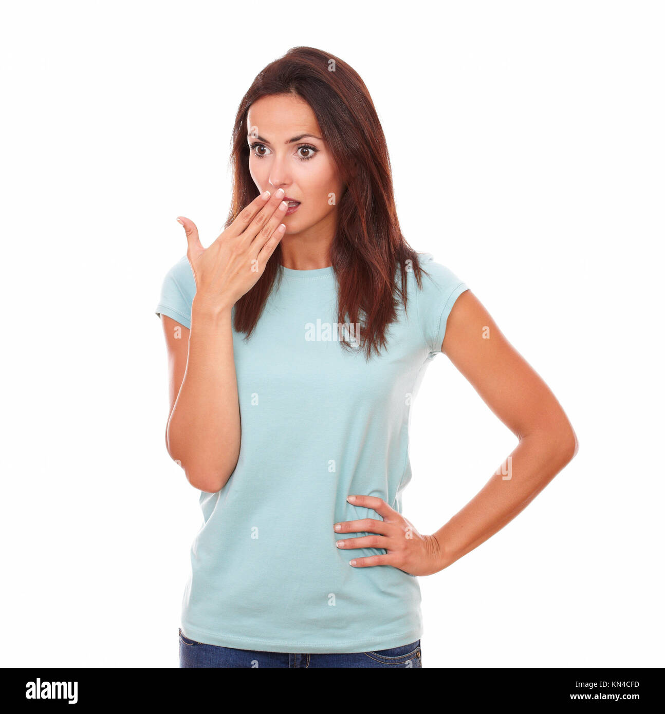 Portrait of surprised attractive 30-35 years woman with the hand in front the mouth, after be wrong on blue t-shirt - Stock Image