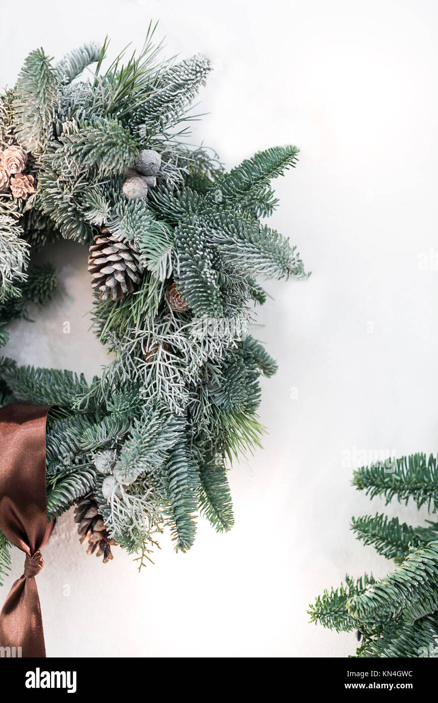 interior design, celebration, home atmosphere concept. simple but lovely wreath made of fresh conifer branches, - Stock Image