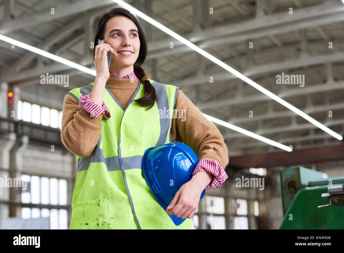Waist-up Portrait of Smiling Technician - Stock Image