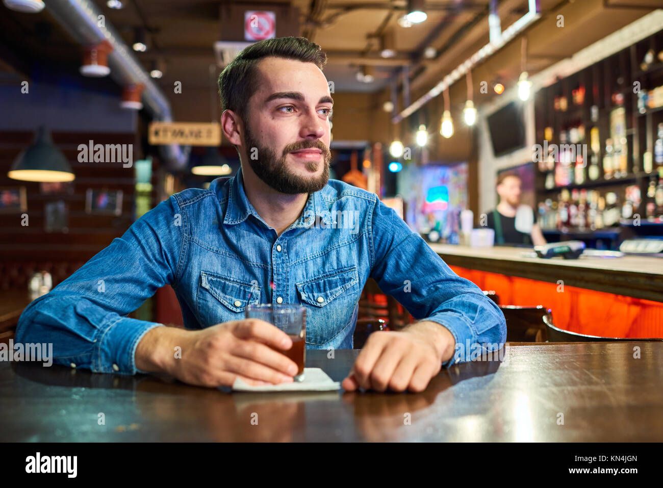 Happy Drunk Man in Bar - Stock Image