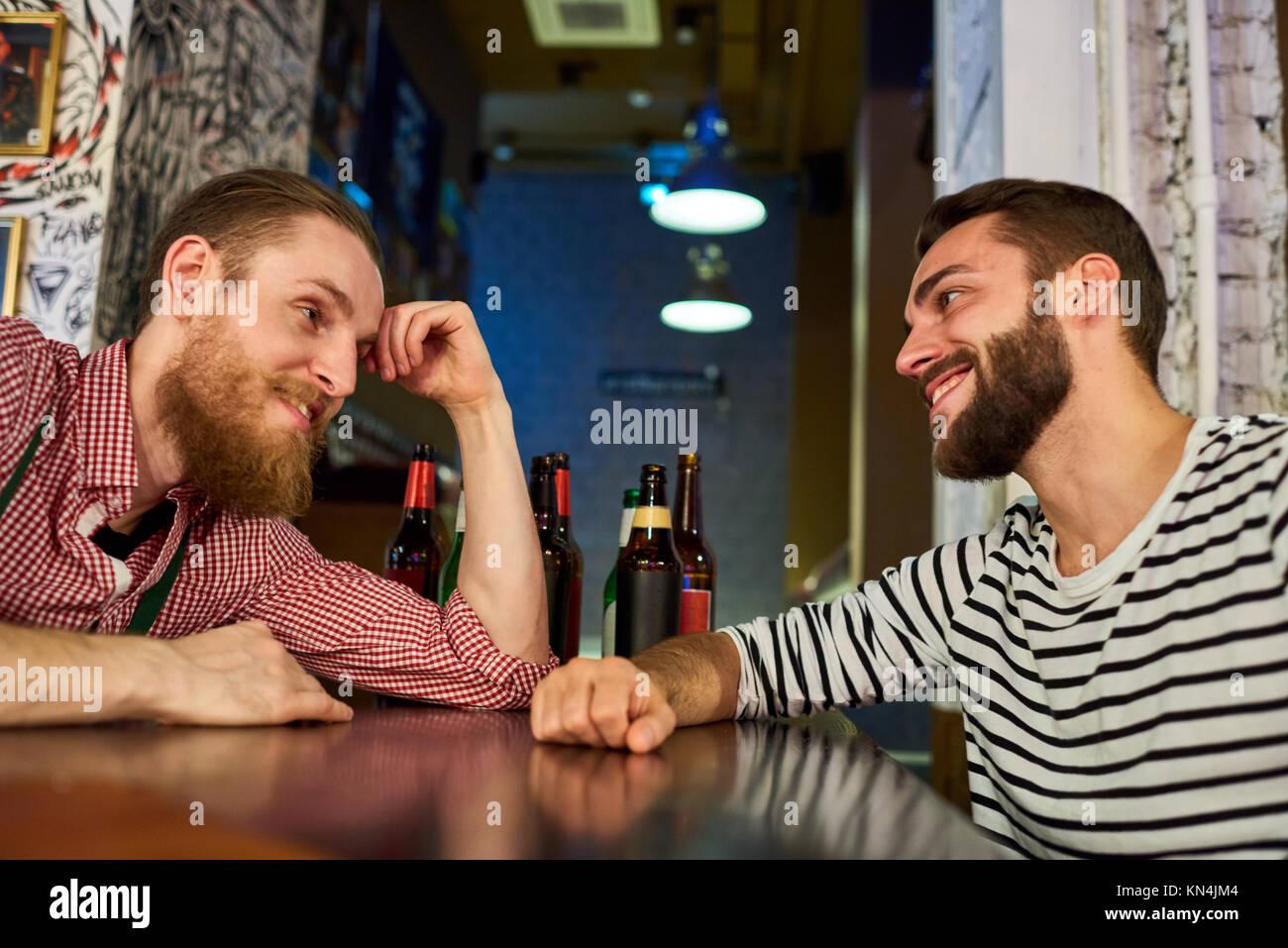 Two Drunk Buddies Talking in Bar - Stock Image