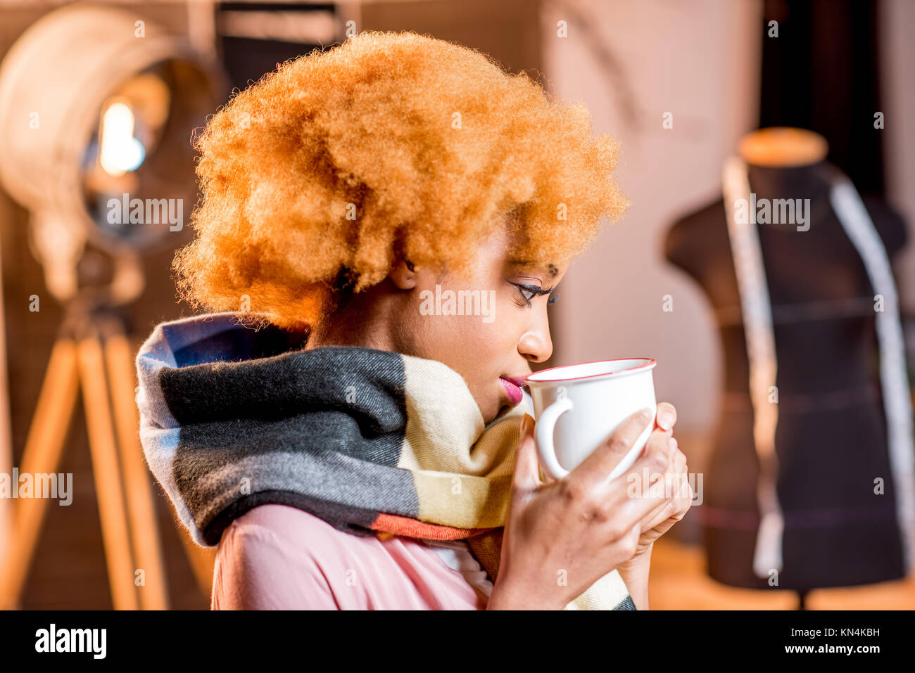 Fashion designer working at the office - Stock Image