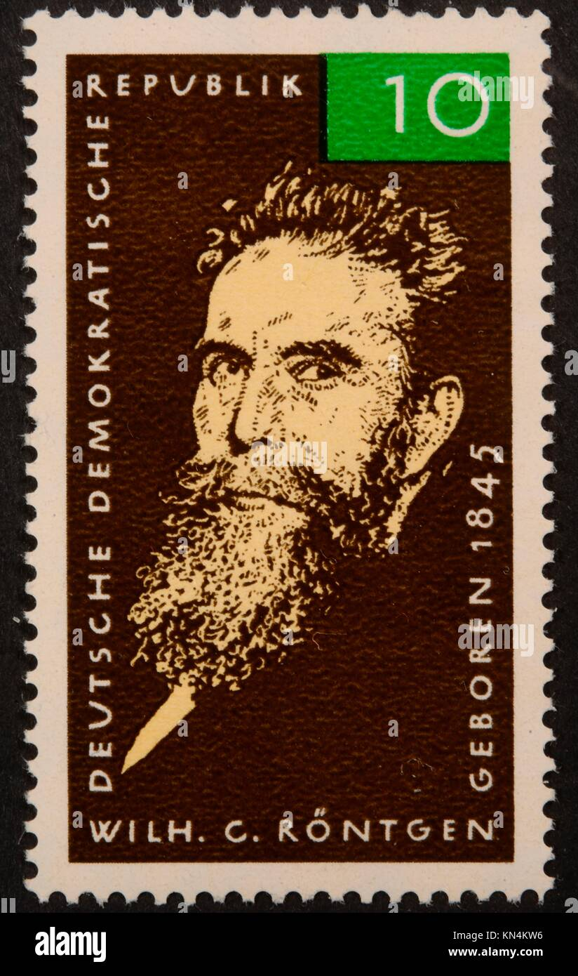 Wilhelm Conrad Röntgen, a German mechanical engineer and physicist, portrait on a East German (DDR) stamp 1965 - Stock Image